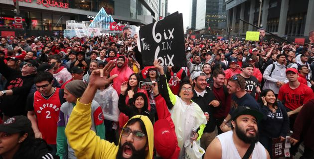 Fans cheer in Jurassic Park as the Toronto Raptors play the Milwaukee Bucks in game six of the NBA Eastern...