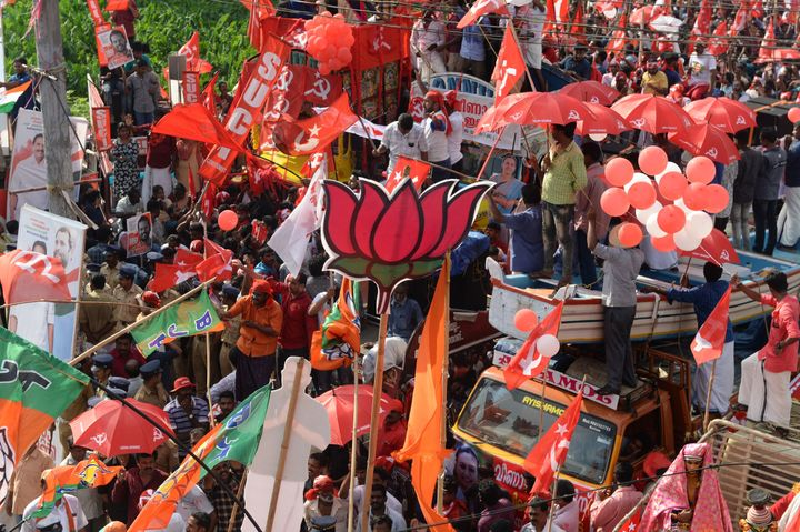 Supporters of the BJP, National Congress Party and Communist Party of India during the final day of election campaigning in Pathanamthitta.