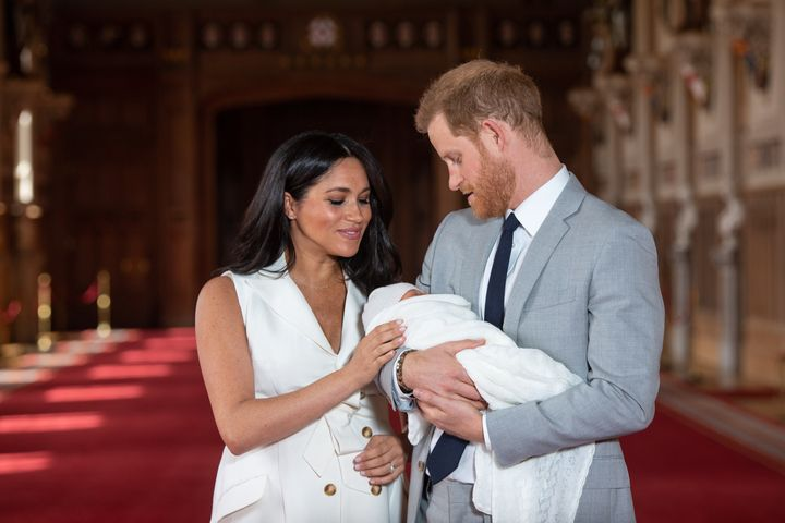 Meghan Markle and Prince Harry show off baby Archie on May 8, 2019. Meghan is probably counting the minutes until she can rip off that outfit and get back into her maternity leggings.