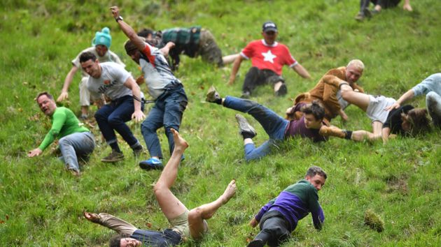 People Throwing Themselves Down A Hill To Catch A Roll Of Cheese Is The Post-Election Levity You
