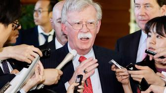 In this Friday, May 24, 2019, photo, U.S. National Security Adviser John Bolton is surrounded by reporters at the prime minister's official residence in Tokyo. Bolton called a series of short-range missiles launched by North Korea last month were violations to U.N. Security Council resolutions, stressing the need to keep sanctions in place. Bolton said Saturday, May 25, 2019, in Tokyo the U.S. position on the North's denuclearization is consistent and that a repeated pattern of failures should be stopped. (Yohei Kanasashi/Kyodo News via AP)