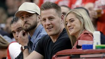 Singer Justin Timberlake, J.J. Watt of the Houston Texans and soccer player Kealia Ohai, from left, watch the second half of Game 5 of the NBA basketball Western Conference finals between the Houston Rockets and the Golden State Warriors in Houston, Thursday, May 24, 2018. (AP Photo/David J. Phillip)