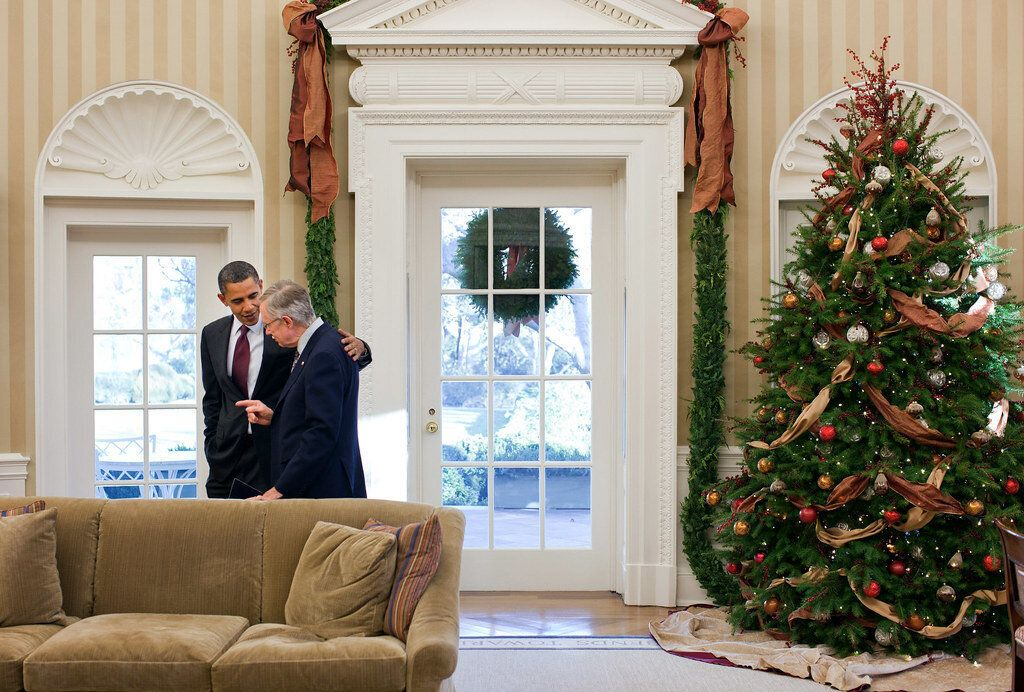 """Obama and Reid talk privately in the Oval Office on Dec. 4, 2010. After congressional Democratic leaders met with the president that day about the agenda for the lame-duck session, the Senate majority leader spoke with Obama about the repeal of """"don't ask, don't tell."""""""