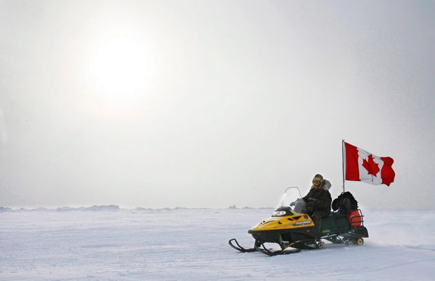Ranger Joe Amarualik, from Iqaluit, Nunavut, drives his snowmobile on the ice during a Canadian Ranger...