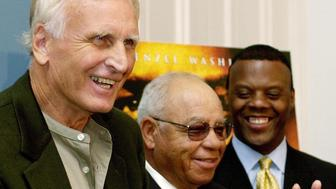 """WASHINGTON, :  US Rep. J.C, Watts, Jr (R-OK) (R) looks on as former Alexandria, Virginia high school foootball coaches Bill Yoast (L) and Herman Boone (C) discuss the Walt Disney Company's latest film """"Remember the Titans"""" 26 September 2000 during a press conference at the US Capitol building in Washington DC.  Yoast and Boone are the coaches portrayed in the film. AFP PHOTO/Joyce NALTCHAYAN (Photo credit should read JOYCE NALTCHAYAN/AFP/Getty Images)"""