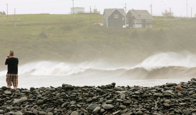 A man videotapes the storm surge created by Hurricane Bill in Cow Bay, N.S., on Aug. 23,