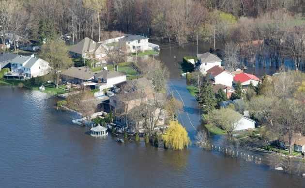 Flooded homes are seen from the air along the banks of the Ottawa River on May 11,