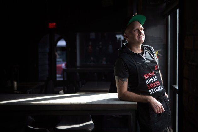 Volunteer chef Mikiki, who has been living with HIV for 10 years, poses for a portrait at the pop up restaurant June's HIV+ Eatery in Toronto, Tues. Nov. 7.