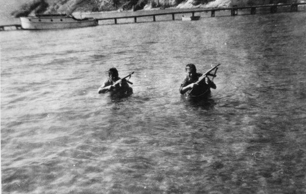 John KoBong and Tom Lock learning to swim silently loaded down with gear in an undated picture.