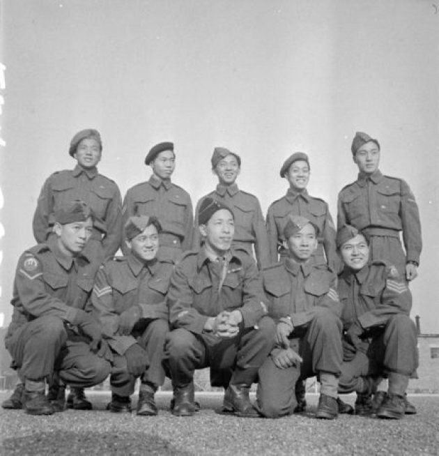 Force 136 men, who were stationed in India, posing for a photograph as they await repatriation to Canada from England.