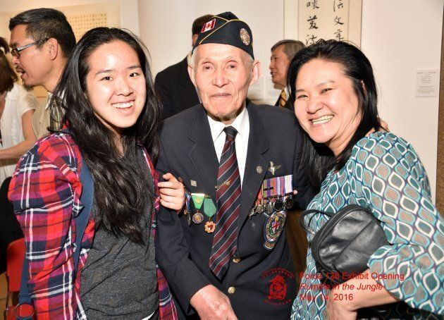 Force 136 member Charlie Lee poses for a photograph with his daughters.