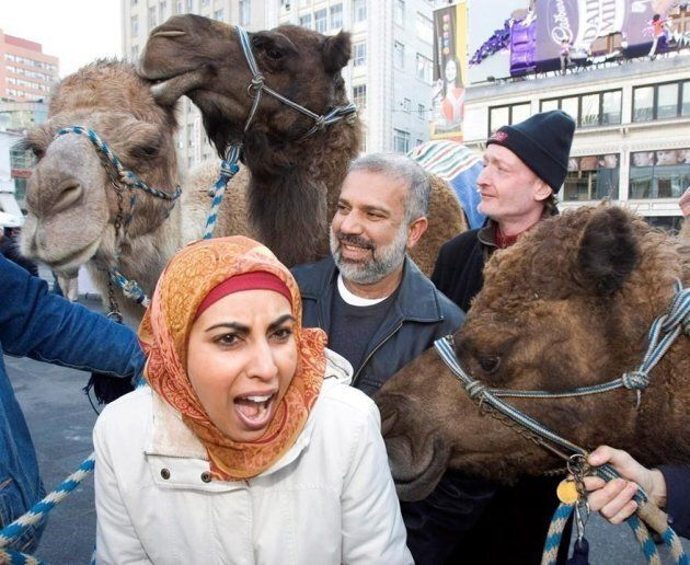 """Little Mosque on the Prairie"" creator Zarqa Nawaz, actor Manoj Sood and actor Boyd Banks ham it up with camels during a promotion for the CBC television show in downtown Toronto on Jan. 4, 2007."