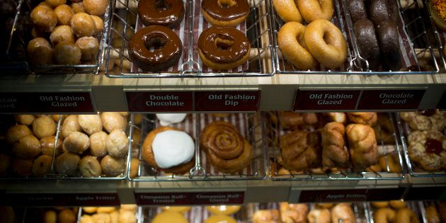Doughnuts sit on display for sale at a Tim Hortons Inc. restaurant in Oakville, Ont., Sept. 16,