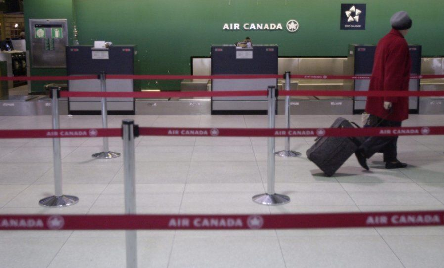 Air Canada's counter at Toronto Pearson International Airport, circa April 2003 when it plunged into...
