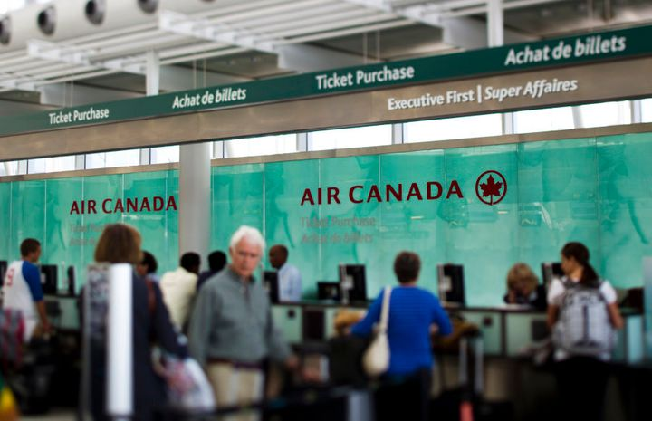 Travellers wait at the Air Canada counter at Toronto Pearson International Airport on Aug. 30, 2011.