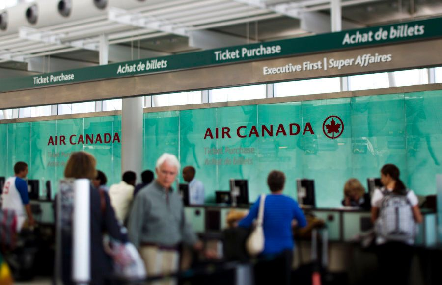 Travellers wait at the Air Canada counter at Toronto Pearson International Airport on Aug. 30,