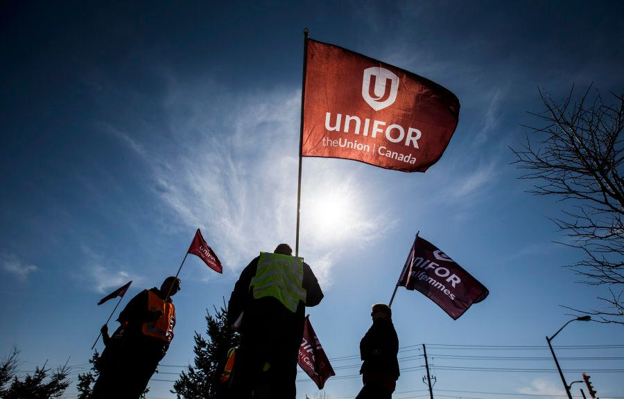 Representatives from Unifor stand outside the Toyota plant in Cambridge, Ont. on March 31, 2014. The...