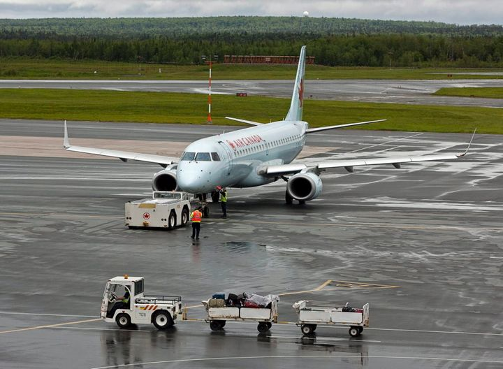 An Air Canada jet is prepared for takeoff at the international airport in Halifax on  June 16, 2011.