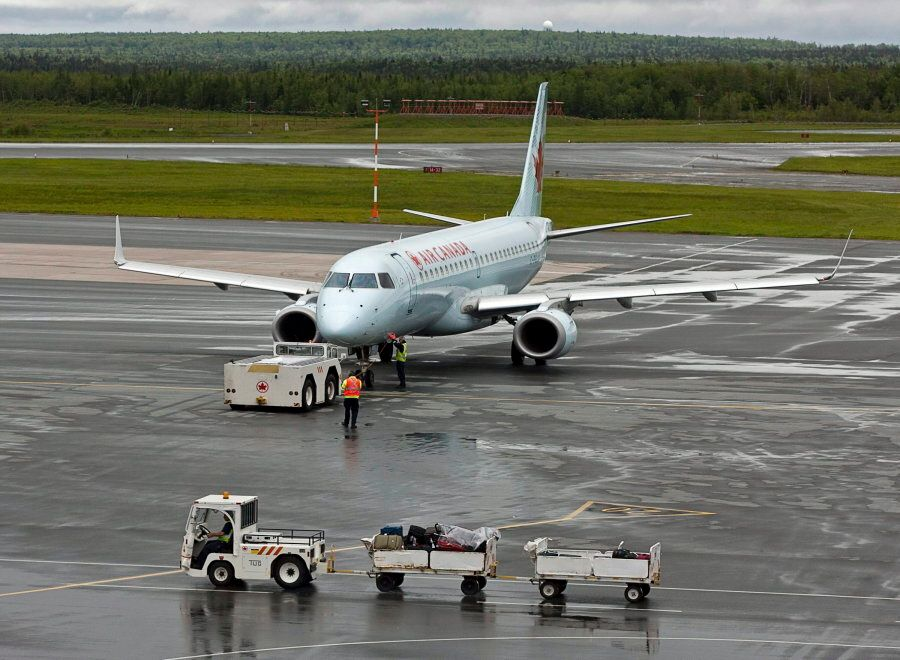 An Air Canada jet is prepared for takeoff at the international airport in Halifax on June 16,