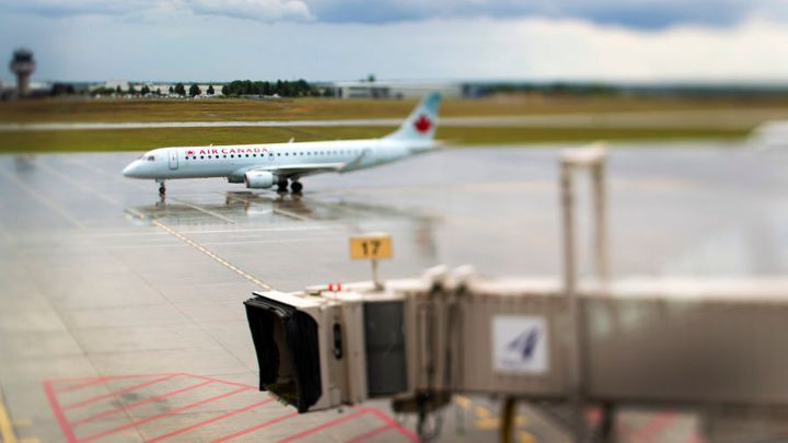 An Air Canada airplane taxis down the tarmac at Ottawa International Airport on Aug. 10, 2011.
