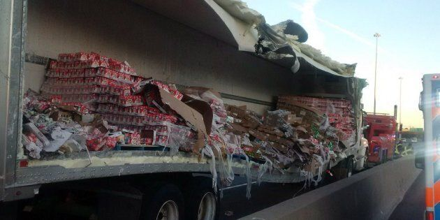 Police say cleanup efforts are underway after a transport truck collision that spilled yogurt onto a...