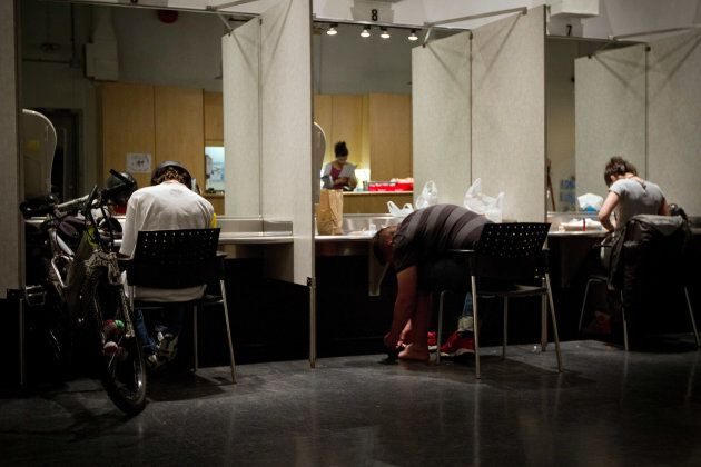 Addicts inject themselves at the Insite supervised injection Center in Vancouver,
