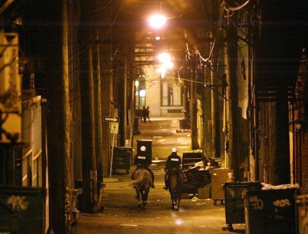 Two mounted Vancouver Police officers patrol one of the many alley ways in Vancouver's Downtown Eastside...