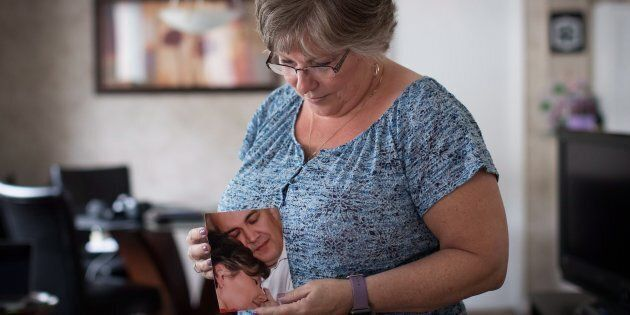 Wendy Gould holds a photograph of her late husband George Gould at her home, in Aldergrove, B.C., on...