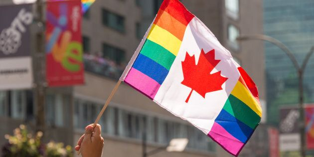 Canadian gay rainbow flag flies at Montreal gay pride parade on Aug. 20,