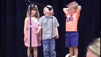Kid takes over group performance in the best way.