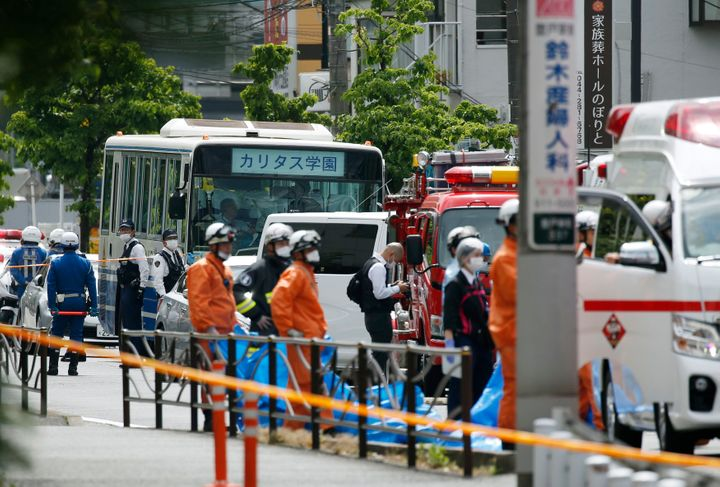 A school bus is parked at the scene of a knife attack in Kawasaki City, near Tokyo, on Tuesday, May 28, 2019.