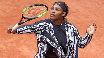 PARIS, FRANCE - MAY 27: Serena Williams of USA wears a special Nike jacket - with French text reading 'Champion, Championne', 'Queen, Reine', 'Goddess, Deesse' and 'Mother, Mere' - during the warm up prior to her first round victory on day 2 of the 2019 French Open at Roland Garros stadium on May 27, 2019 in Paris, France. (Photo by Jean Catuffe/Getty Images)