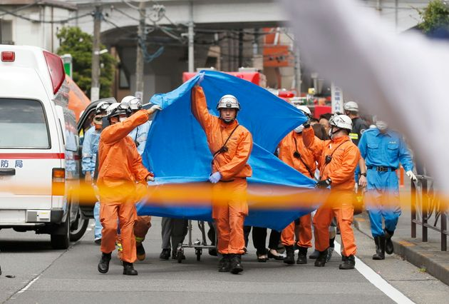 Rescuers work at the scene of an attack in Kawasaki, near Tokyo, on May 28,
