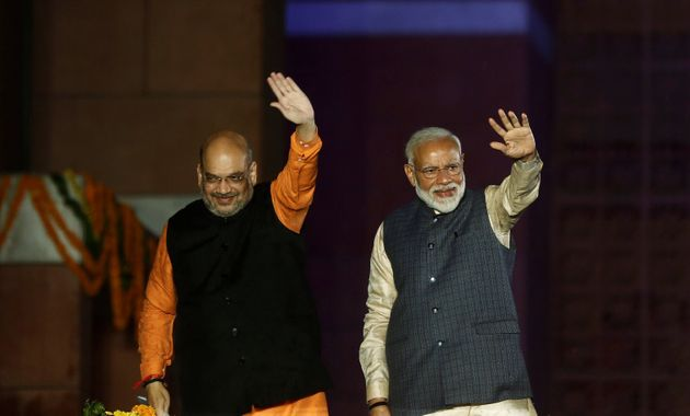 Prime Minister Narendra Modi and BJP President Amit Shah wave at their supporters after the election...
