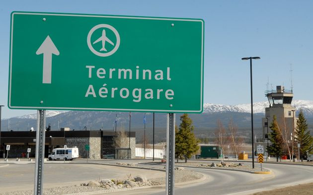 A terminal direction sign is seen here at the Whitehorse International Airport in 2009. A Cessna 170...
