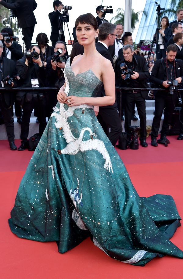 "The model wears a gown by Gyunel Couture for the closing ceremony screening of ""The Specials on May 25."