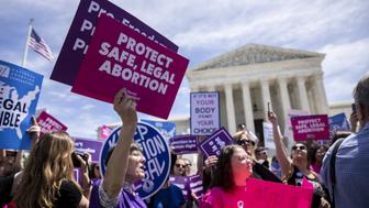Pro-choice activists holds signs during a rally in front of the U.S. Supreme Court in Washington, D.C., U.S., on Tuesday, May 21, 2019. The U.S. Supreme Court on Monday deferred acting on state efforts to put more restrictions on abortion, issuing a list of orders without mentioning two pending Indiana appeals. Photographer: Anna Moneymaker/Bloomberg via Getty Images