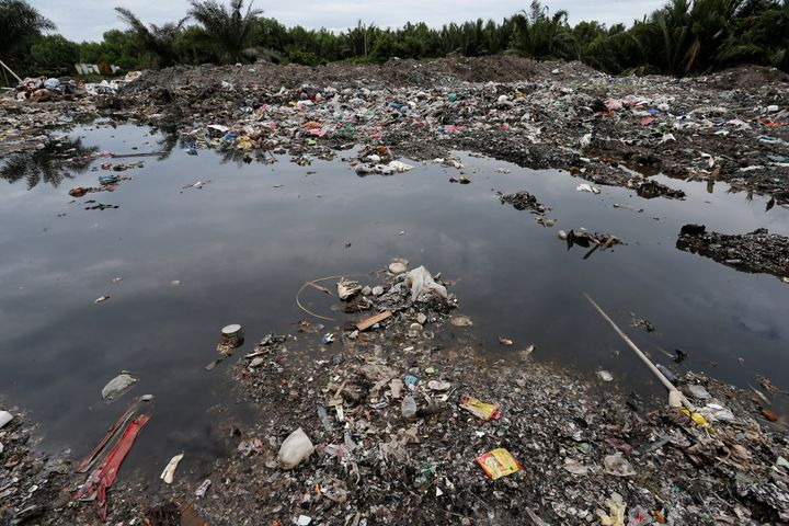 Plastic waste is seen dumped at a palm oil plantation in Telok Panglima Garang, Malaysia in October.