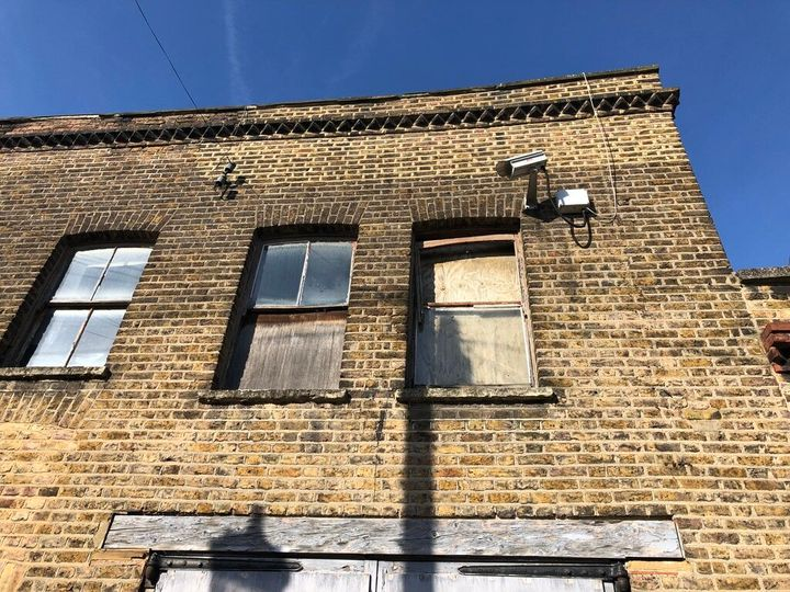 Windows at the Hewer Street property are boarded up
