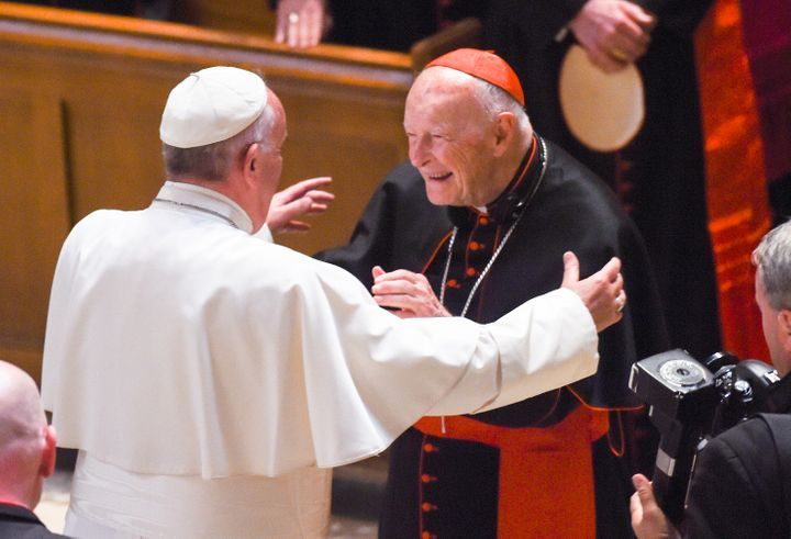 Pope Francis reaches out to hug Theodore McCarrick during a 2015 service in Washington, DC. McCarrick has since been defrocked.