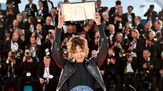 "TOPSHOT - French actress and film director Mati Diop poses during a photocall with her trophy after she won the Grand Prix for her film ""Atlantics (Atlantique)"" on May 25, 2019 during the closing ceremony of the 72nd edition of the Cannes Film Festival in Cannes, southern France. (Photo by Alberto PIZZOLI / AFP)        (Photo credit should read ALBERTO PIZZOLI/AFP/Getty Images)"