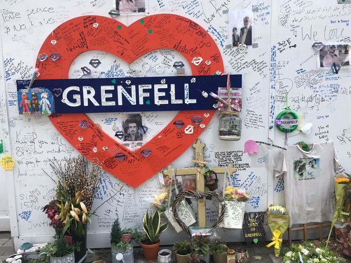 A memorial to the 72 people killed in the Grenfell fire on the hoardings surrounding the tower block