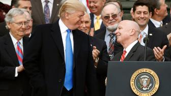 """The Center for Public Integrity has a new report examining how Republicans created and passed their tax cuts package in 2017.Here's an overview from the piece:""""What would become known as the 2017 Tax Cuts and Jobs Act, or more commonly, the Trump tax cuts, was officially launched with six sentences in Trump's first address to Congress on Feb. 28. There would be a 'big, big cut' for companies, and 'massive tax relief for the middle class,' he said. 'Have to do it.' For Republicans, the idea held promise.But by the time the measure was signed into law 10 months later, it had ridden a roller-coaster ride of flip-flops, exaggeration, hypocrisy, falsehoods and contortions. Rosy estimates of economic growth were summoned from right-wing pro-growth think tanks. Budgeting gimmicks made deficits disappear. Deals were cut. Historic Republican concerns about the long-term debt were abandoned. The result: flawed and ill-considered legislation that disappointed some tax experts ... and utterly flummoxed others.""""Read the full report on The Center for Public Integrity website.Like what you're reading? Sign up for our free newsletter."""