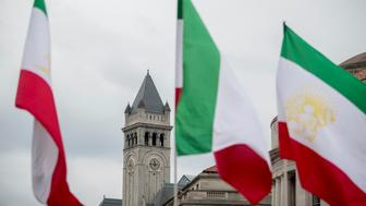 The tower of the Old Post Office, now the Trump International Hotel is visible through Iranian flags during an Organization of Iranian-American Communities rally at Freedom Plaza in Washington, Friday, March 8, 2019. (AP Photo/Andrew Harnik)