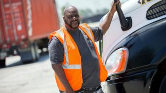 In this Wednesday, May 22, 2019 photo, Leon Brown stands by his tractor-trailer after making a delivery from a distribution center to the Port of Savannah, in Garden City, Ga. Brown is trusted enough to drive a tractor-trailer inside one of the nation's busiest seaports more than six years after being released from prison. But he's not allowed to vote in Georgia because of a law rooted in the years after the Civil War when whites sought to keep blacks from the ballot box. (AP Photo/Stephen B. Morton)