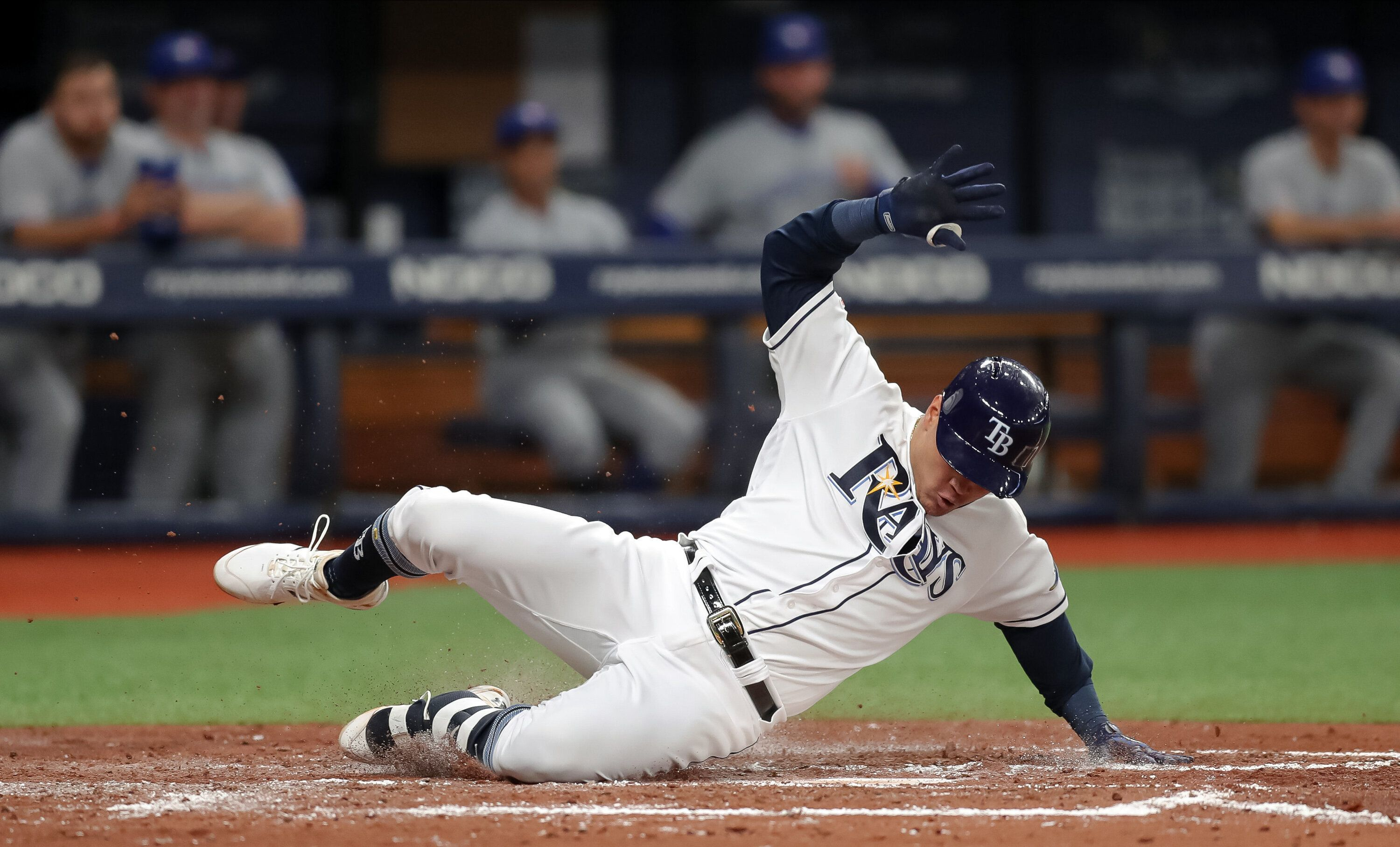ST. PETERSBURG, FL - MAY 28: Avisail Garcia #24 of the Tampa Bay Rays slides in with an inside-the-park home run in the third inning of a baseball game against the Toronto Blue Jays at Tropicana Field on May 28, 2019 in St. Petersburg, Florida. (Photo by Mike Carlson/Getty Images)
