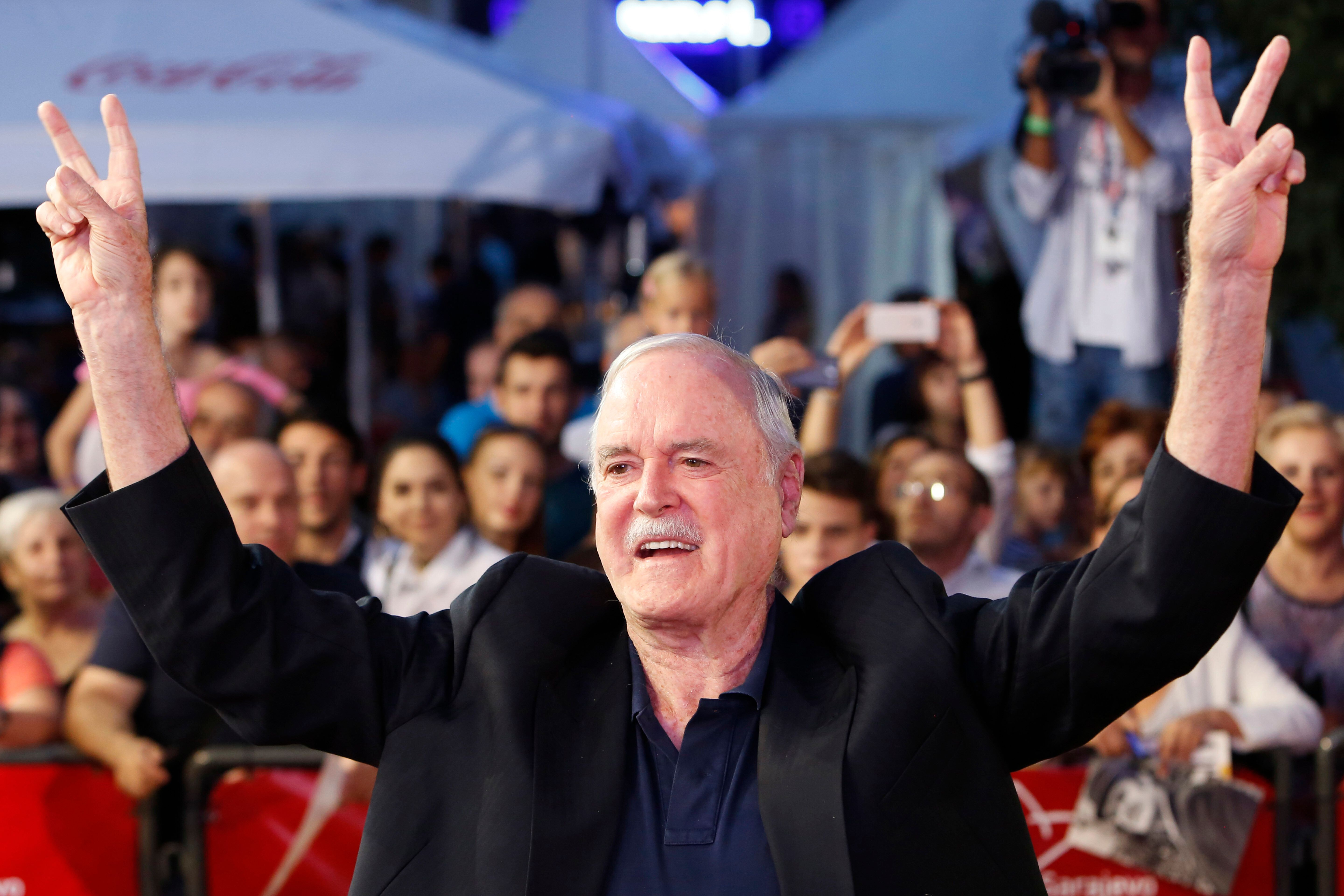 English actor John Cleese poses for photos as he walks on the red carpet to receive Sarajevo Film Festival's top honour award, the Heart of Sarajevo Award, in Sarajevo, Bosnia, on Wednesday, Aug. 16, 2017. (AP Photo/Amel Emric)
