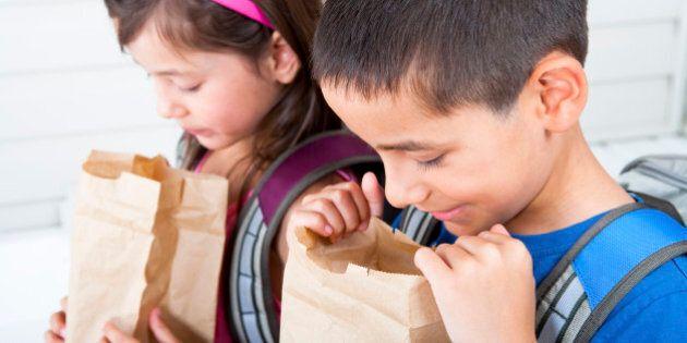 Siblings 6/7 digging in their school lunch
