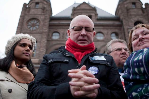 Sid Ryan of the Ontario Federation of Labour pauses before speaking to protesters gathered outside the Ontario Legislature in Toronto on April 21, 2012.