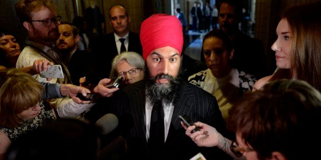 NDP Leader Jagmeet Singh speaks to reporters in the Foyer of the House of Commons on Parliament Hill...